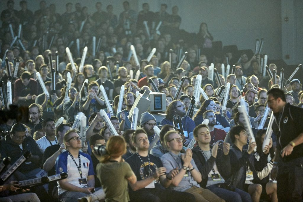 Olympic esports can draw crowds such as this group cheering for Overwatch during the 2016 BlizzCon World Cup